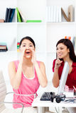 Businesswoman yelling in the office Royalty Free Stock Image