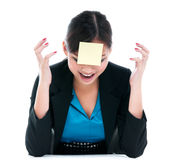 Businesswoman Yelling With Paper On Forehead Stock Images