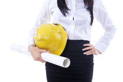 Businesswoman yellow hat and plan Stock Image