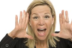 Businesswoman yells. Businesswoman in a suit yells and gestures with her hands Royalty Free Stock Photos