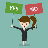 Businesswoman with a Yes or No sign. Stock Photography