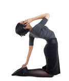 Businesswoman in yoga pose with cell phone Stock Photo