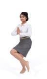 Businesswoman in yoga position stock photos