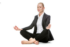 Businesswoman in yoga position Royalty Free Stock Photos