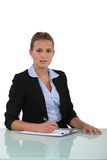 Businesswomanat her desk Royalty Free Stock Photos