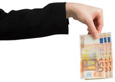 Businesswomans hand holding fifty euro notes Stock Photo