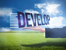 Businesswomans hand presenting the word develop Royalty Free Stock Photo