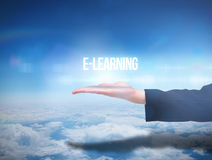 Businesswomans hand presenting the word e learning Royalty Free Stock Image