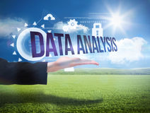 Businesswomans hand presenting the words data analysis Stock Photos