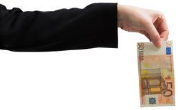 Businesswomans hand som rymmer euro femtio royaltyfria bilder