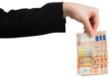 Businesswomans hand som rymmer femtio euroanmärkningar Arkivfoto