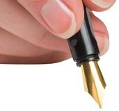 Businesswomans hand writing with fountain pen Royalty Free Stock Image