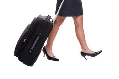 Businesswomans legs with suitcase Royalty Free Stock Photos