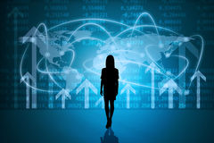 Businesswomans silhouette with world map Stock Photo