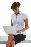 Businesswomanusing her laptop Royalty Free Stock Photos