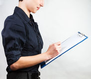 Businesswomen. Woman writes something on a piece of Royalty Free Stock Photo