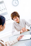Businesswomen. Senior businesswoman and assistant working in the office Royalty Free Stock Images
