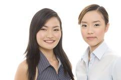 Businesswomen 5. Two attractive asian businesswomen - both in focus Stock Image