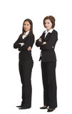 Businesswomen. Two confident businesswomen standing up against a white background Royalty Free Stock Photos