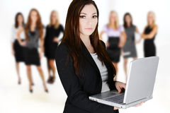 Businesswomen. Of all races working together in an office Stock Photo