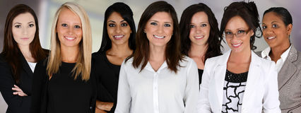Businesswomen. Of all races working together in an office royalty free stock images