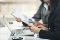 Businesswomen analysing the graphics Stock Photo