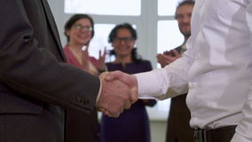 Businesswomen applause at the office. Two brunette businesswomen applausing at the office. Close up of male hands shaking against background of two women and one stock video footage