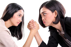 Businesswomen arm wrestling close up Royalty Free Stock Photo