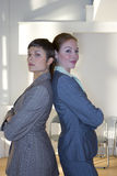 Businesswomen back to back, portrait Royalty Free Stock Images