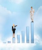 Businesswomen with big 3d chart Royalty Free Stock Photo
