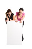 Businesswomen and billboard. A shot of two businesswomen looking at a blank billboard stock images