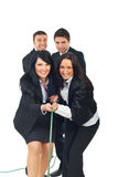 Businesswomen and businessmen play tug of war Stock Photos