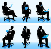 Businesswomen and businessmen silhouettes Stock Photography