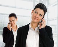 Businesswomen calling phone Stock Images