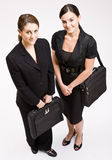 Businesswomen carrying briefcases. Two business women carrying briefcases Royalty Free Stock Photos