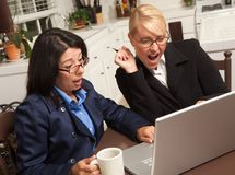 Businesswomen Celebrate Success on the Laptop Stock Images