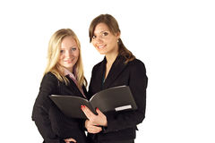Businesswomen checking a file Royalty Free Stock Photo