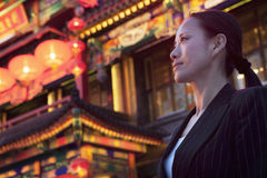 Businesswomen with Chinese architecture in background. Royalty Free Stock Image
