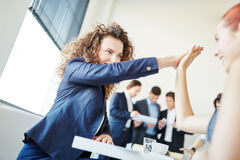Businesswomen clap each other hands. As motivation for success Royalty Free Stock Image