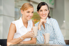 Businesswomen with Coffee. Two attractive businesswomen chatting over coffee Stock Photo