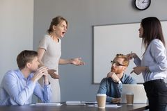 Businesswomen colleagues disputing at corporate office meeting,. Business women colleagues disputing arguing at corporate office meeting, mad angry shocked royalty free stock photography