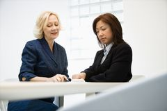 Businesswomen communicating Stock Images
