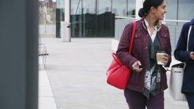 Businesswomen Commuting To Work. Two businesswomen are commuting to work together in the city stock video