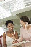 Businesswomen In Conference Meeting One Using Mobile Phone Royalty Free Stock Photography