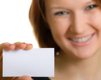 Businesswomen contacts. Girl with a business card Royalty Free Stock Photos