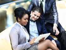 Businesswomen With Digital Tablet Sitting Stock Images