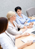 Businesswomen discuss business plan Stock Photo