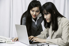 Businesswomen discussing on computer Royalty Free Stock Image