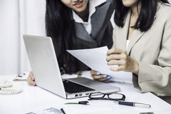 Businesswomen discussing on computer Stock Images