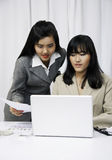 Businesswomen discussing on computer Royalty Free Stock Photos